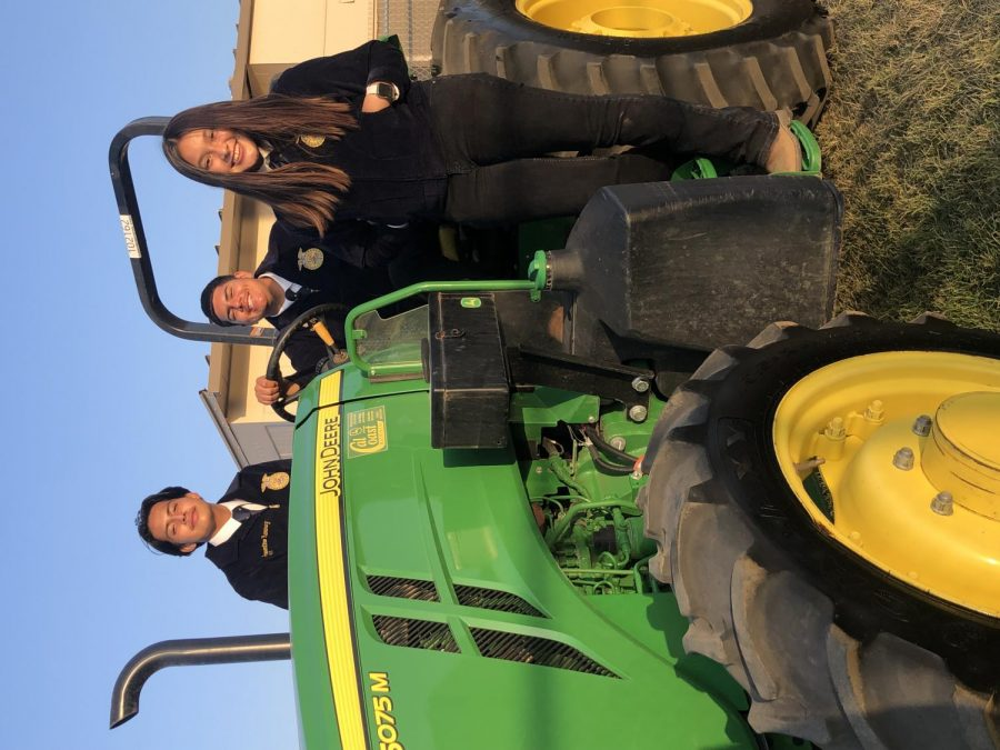 FFA Students take a moment during the evening to pose with their equipment.