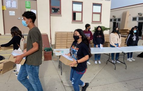 Students from each second period where on hand Thursday to help distribute the 2021/2022 student agenda books back in their classes.