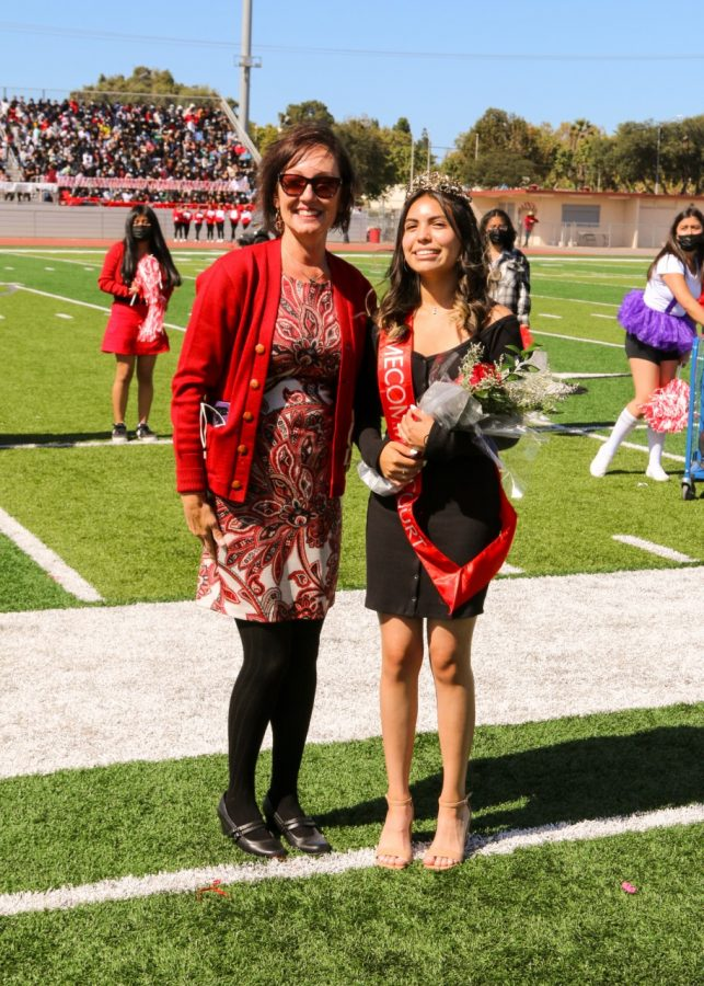 Dianna+Perez%2C+escorted+by+Ms.+Quaid%2C+was+crowned+Homecoming+Princess+at+the+rally.